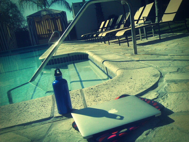 Laptop by the swimming pool